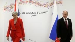 Мертвое лицо Терезы Мэй при встрече с Владимиром Путиным на саммите в Осаке 28 июня 2019