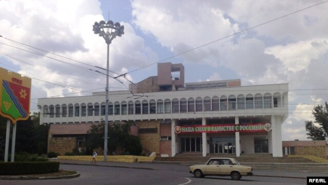 """The administrative building on Tiraspol's central square sports a banner reading: """"Our strength is in unity with Russia."""""""