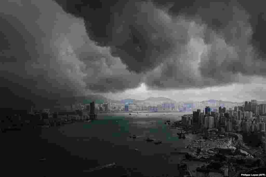 Clouds build up over Victoria Harbor before a storm in Hong Kong. (AFP/Philippe Lopez)