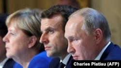 Presidenti rus, Vladimir Putin, kancelarja gjermane, Angela Merkel dhe presidenti i Francës, Emmanuel Macron.