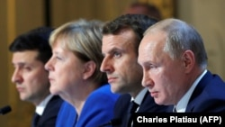 Ukrainian President Volodymyr Zelenskiy, (left to right) German Chancellor Angela Merkel, French President Emmanuel Macron, and Russian President Vladimir Putin attend a press conference after a summit on Ukraine at the Elysee Palace in Paris in December 2019.