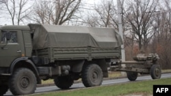 A truck tows a 122-millimeter artillery piece on a main road east of Donetsk on November 11.