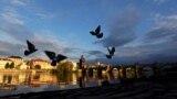 CZECH REPUBLIC -- Birds fly over the Vltava river bank near Charles Bridge amid an outbreak of the coronavirus disease (COVID-19) in Prague, April 29, 2020