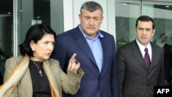 Opposition leaders Salome Zurabishvili, Levan Gachechiladze, and Irakli Alasania (left to right) leave their meeting with President Mikheil Saakashvili in Tbilisi.