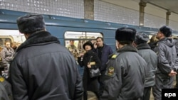 Police guard a metro station in Moscow a day after the deadly bombings. Kyiv wants to step up its security to prevent similar attacks.