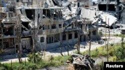 Ілюстраційне фото: знищений танк урядових військ в одному з районів Хомса, фото 28 квітня 2013 року