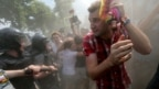 A gay-rights activist tries to escape threats from antigay protesters at a gay-pride event in St. Petersburg, Russia. (file photo)