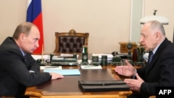 Daghestan's President Mukhu Aliyev (right) meets with Russian Prime Minister Vladimir Putin in March.