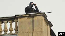 Germany -- A police sniper keeps watch from the roof of the Orangerie near Sanssouci Palace in Potsdam, 08Sep2010