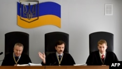 Колегія суддів у справі за обвинуваченням у державній зраді екс-президента України Віктора Януковича на попередньому засіданні, 26 червня 2017 року