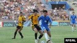من مباراة بين فريقي أربيل والنجف في ملعب الشعب الدولي ببغداد