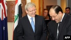 Kevin Rudd (L) and Nuri al-Maliki