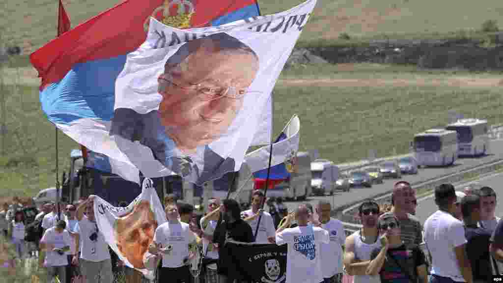 Ethnic Serbs carry national flags and pictures of ultranationalist leader Vojislav Seselj as they gather in Gazimestan.