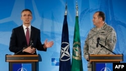 NATO Secretary-General Jens Stoltenberg (left) and NATO's top military commander, General Philip Breedlove, address the media at the headquarters of Allied Command Operations in Casteau, Belgium on March 11.