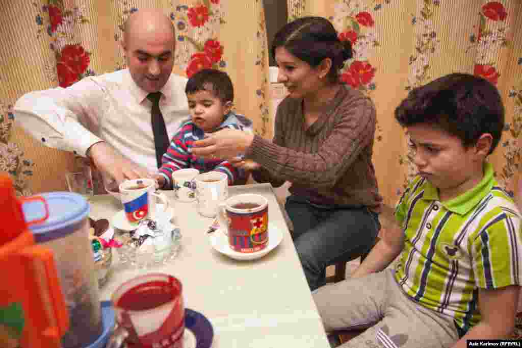 The family enjoying tea