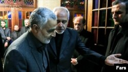 IRGC Qods force commander Qassem Soleimani attending funeral of Zarif's mother in 2013. File photo