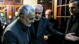 IRGC Qods force commander Qassem Soleimani attending funeral of Zarif's mother in 2013. File photo