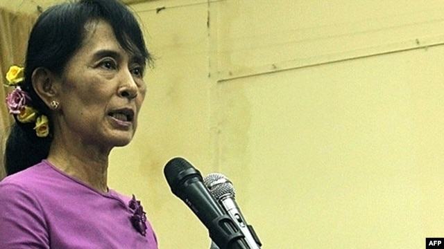 Aung San Suu Kyi speaks at a meeting inside the National League For Democracy party headquarters in Yangon on November 18.