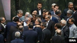 Iranian MPs are seen during a meeting of the Iranian parliament, undated