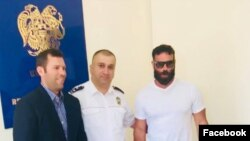 Armenia - Mnatsakan Bichakhchian C), the head of an Armenian police department on visas and passports, poses for a photo with U.S. celebrity Dan Bilzerian (R) and his brother Adam in Yerevan, 27 August 2018.