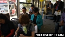 People using wireless internet in public bus.