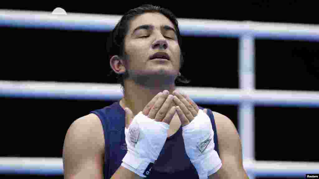 Tajikistan's Mavzuna Chorieva reacts after losing the women's light (60-kilogram) semifinal boxing match in London. (Reuters/Damir Sagolj)