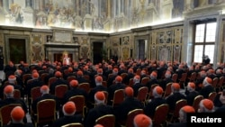 Pope Benedict XVI addressing a meeting of cardinals during his last such meeting at the Vatican on February 28.