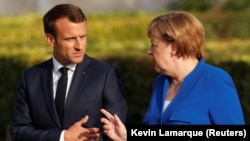 German Chancellor Angela Merkel (right) and French President Emmanuel Macron are the most confidence-inspiring world leaders according to a new global survey.