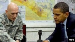 U.S. President Barack Obama is briefed by General Ray Odierno, commander of U.S. troops in Iraq, at Camp Victory in early April.