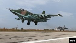 A Russian SU-25 strike fighters takes off from the Hmeymim airbase, outside Latakia in Syria. The emergence of the self-declared Islamic State extremist group in the region has allowed Moscow to intervene in the Syrian conflict under the guise of combating the group's horrific atrocities.