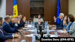 The government led by Prime Minister Maia Sandu (center) meets in the parliament building in Chisinau on June 10.
