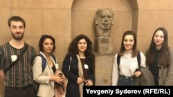 (l-r) Havel Fellows Tornike Mandaria, Gulnar Salimova, Hermine Virabyan, Victoria Colesnic, and Karina Merkuryeva, with the bust of Czech President Vaclav Havel at the U.S. Capitol in Washington.