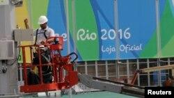 Рио-де-Жанейро қаласындағы олимпиада паркінің жұмысшылары. Бразилия, 30 шілде 2016 жыл.