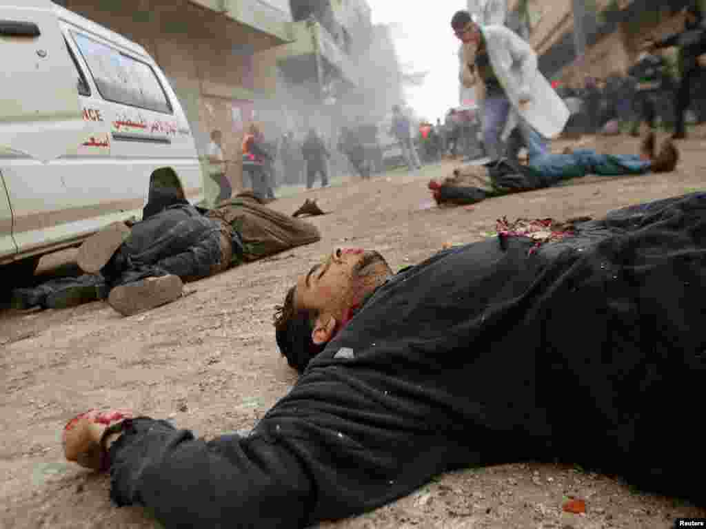 Unidentified bodies lie on a street in the Jabalya refugee camp in northern Gaza Strip early March 6, 2003. Israeli forces killed at least 11 Palestinians and injured more than 140, including some torn apart by a tank shell, in a major raid in the Gaza Strip on Thursday after a suicide bomber killed 15 people in Israel yesterday. REUTERS/Ahmed Jadallah