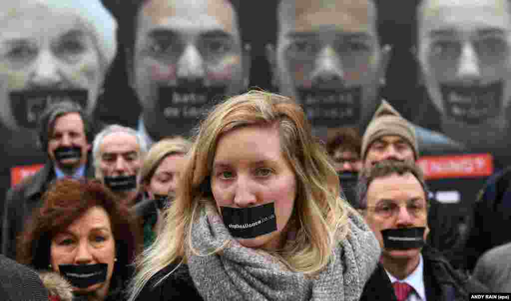 Stop The Silence campaigners launched a nationwide poster outside the British Parliament in London. They are calling for the House of Lords to make amendments to the Article 50 bill and for the public to speak out over the government's hard Brexit policy. (epa/Andy Rain)