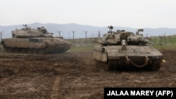 Israeli army Merkava tanks gather in the Israeli-annexed Golan Heights, on January 20, 2019.