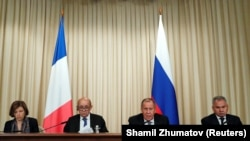 (left to right:) French Defense Minister Florence Parly, French Foreign Minister Jean-Yves Le Drian, Russian Foreign Minister Sergei Lavrov and Russian Defense Minister Sergei Shoigu attend joint press conference in Moscow on September 9.