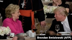 U.S. Democratic presidential nominee Hillary Clinton (left) shares a word with her Republican rival Donald Trump at the Alfred E. Smith Memorial Foundation Dinner in New York earlier this month.