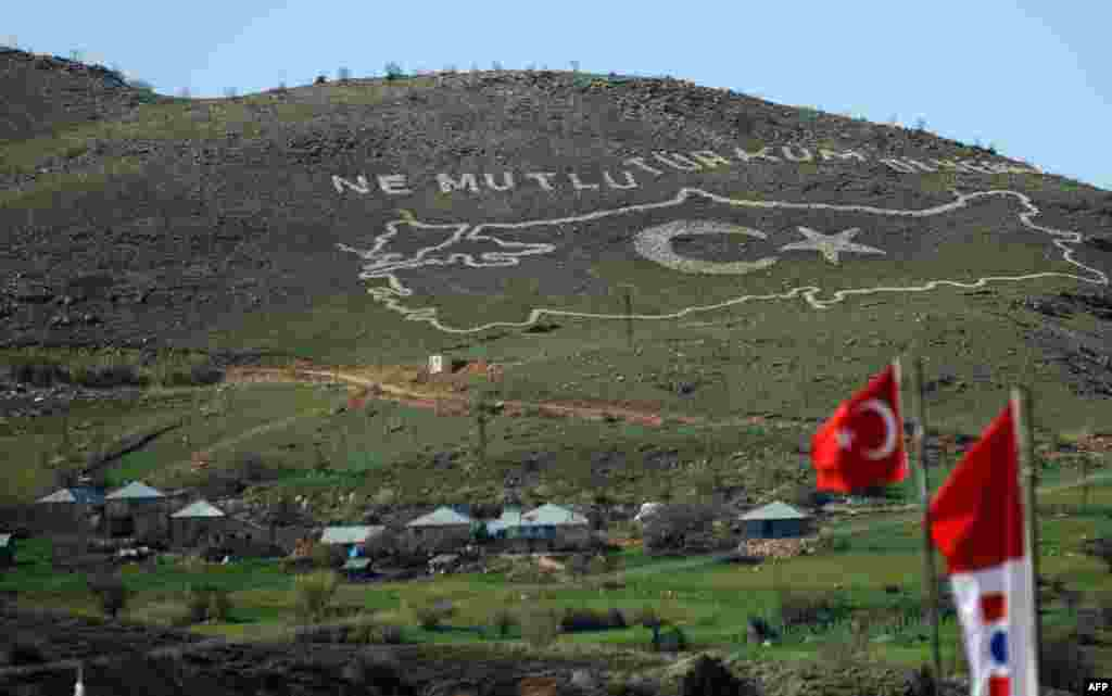 "A giant map of Turkey, etched on a hillside outside the village of Hozat by Turkish Army soldiers, reads: ""How happy is he/she who said, 'I am Turkish."""