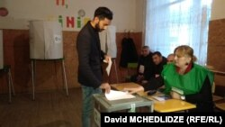 A young Georgian man casts his vote in Marneuli on October 28.