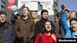 Protesters shout slogans on Pushkin Square during a rally against corruption in the government in Moscow on March 26.