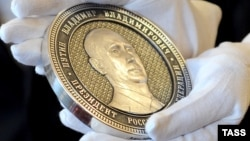 Russia – A commemorative silver coin bearing a portrait of Vladimir Putin to mark the Kremlin's takeover of Crimea, Chelyabinsk, April 23, 2014