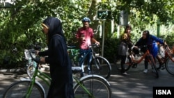 Men and women cycling in Iran. File photo