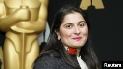 Sharmeen Obaid-Chinoy from the Oscar-nominated documentary short subject A Girl in the River: The Price of Forgiveness poses at a reception ahead of the upcoming 88th Academy Awards ceremony in Beverly Hills on February 24.
