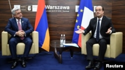 Poland -- French President Francois Hollande (R) and Armenian Prime Minister Serzh Sargsyan have taken seat for bilateral talks on the sidelines of a NATO summit in Warsaw, Poland, on July 9, 2016.