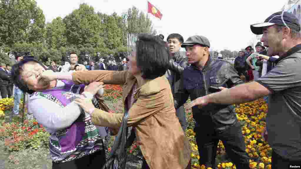 Participants fight during an opposition rally on October 3 in the Kyrgyz capital, Bishkek, where demonstrators demanded the nationalization of the country's biggest gold mine. (Reuters/Vladimir Pirogov)