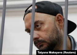 Russian theater director Kirill Serebrennikov, detained on suspicion of embezzling $1.1 million in government funds, is shown in a Moscow courtroom on August 23.
