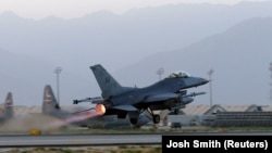 A U.S. Air Force F-16 Fighting Falcon aircraft takes off for a nighttime mission at Bagram Airfield (file photo)