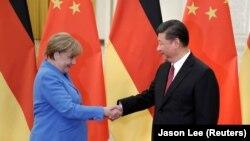Ангела Меркел жана Си Цзиньпин. Бээжин, 24-май, 2018-жыл.