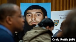 A photo of Sayfullo Saipov is displayed at a news conference at One Police Plaza on November 1.